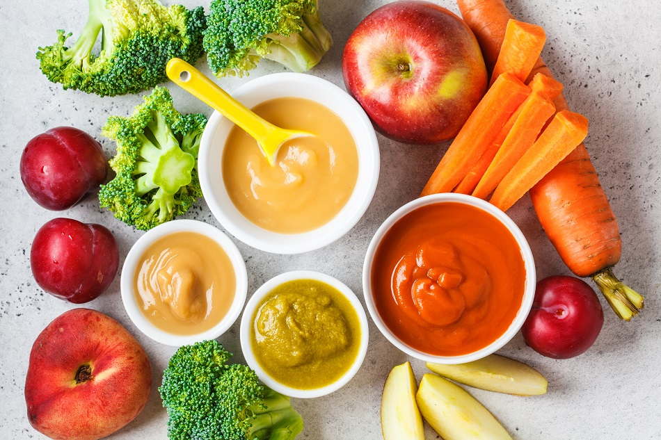 Vegetable and fruit baby puree in white bowls with ingredients. Baby food concept.